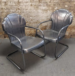 Stunning pair of polished steel mid century Shell chairs