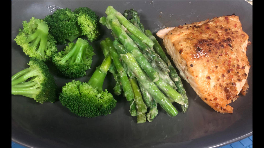 Baked salmon, steamed broccoli, and asparagus with a garlic cream sauce.