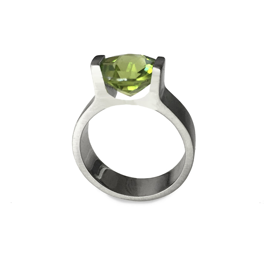 Izaskun Zabala fine jewelry custom 14K white gold engagement ring with peridot brilliant cut stone