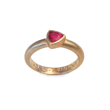 Izaskun Zabala fine jewelry custom 24K yellow gold engagement ring with ruby trillion cut stone