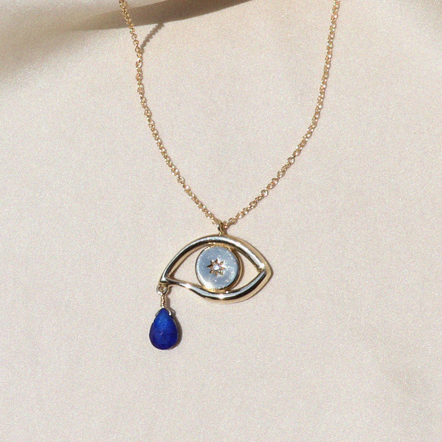 Izaskun Zabala jewelry eye pendant with white sapphire stone and lapis lazuli pear shaped dangling bead necklace