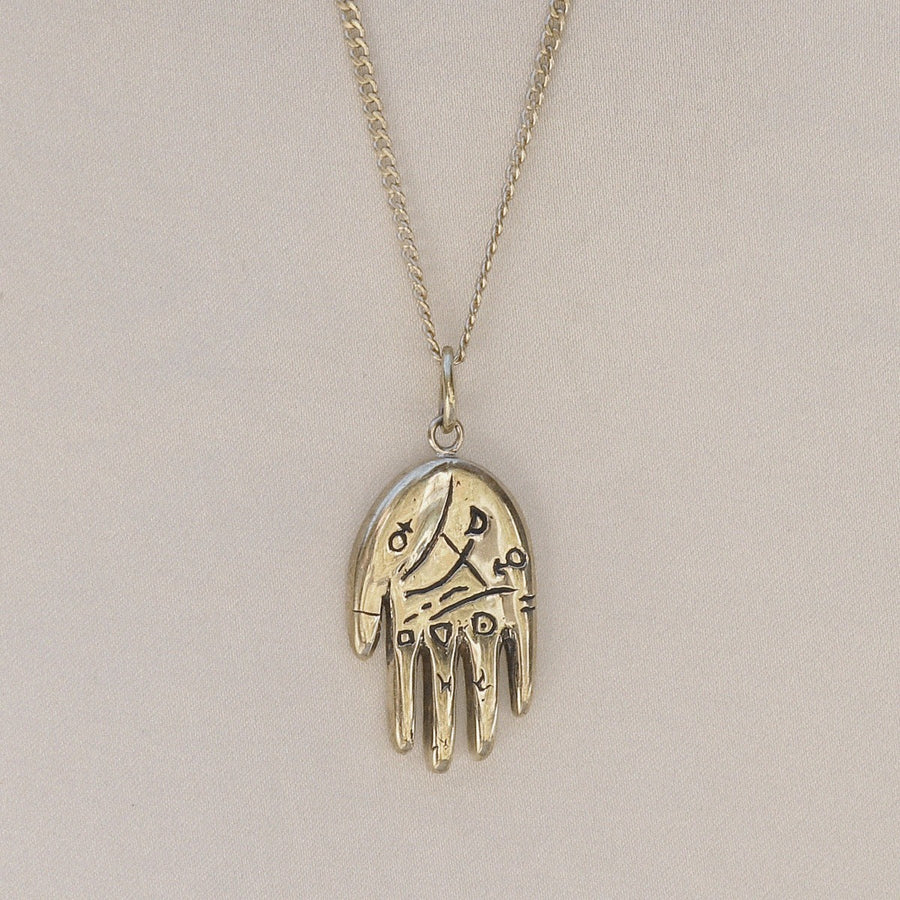 Izaskun Zabala jewelry reversible hand palmistry necklace with astrological symbols