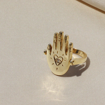 Izaskun Zabala jewelry reversible hand palmistry ring with astrological symbols