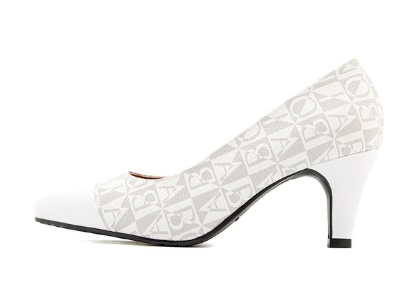 Thelma Monogram Pumps