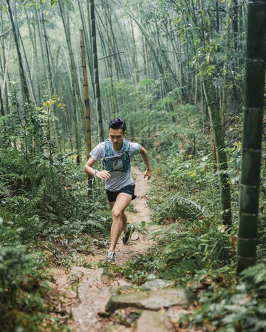 man trail running in forest, china