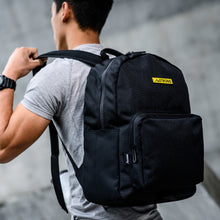 Load image into Gallery viewer, man in grey shirt wearing a black backpack