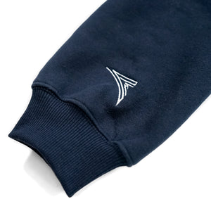 navy blue sleeve with a AmSTRONG embroidered logo