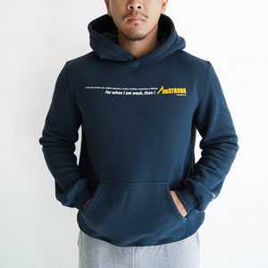 man in navy blue hoodie with his hands inside the kangaroo pocket