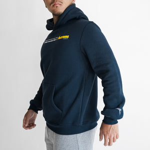 man in a navy blue hoodie which has a statement print in the front