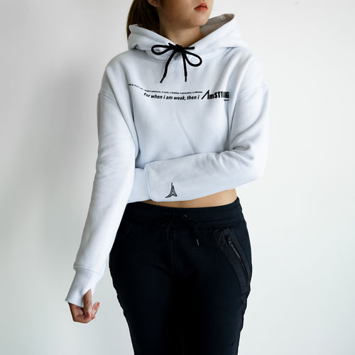 woman in white cropped hoodie and black pants