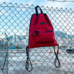 a red drawstring bag being hanged