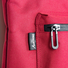 Load image into Gallery viewer, AmSTRONG woven label and waterproof zip on red fabric