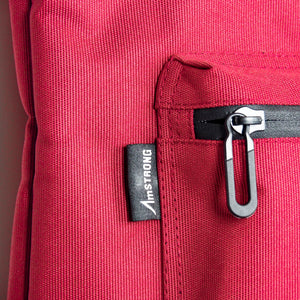 AmSTRONG woven label and waterproof zip on red fabric