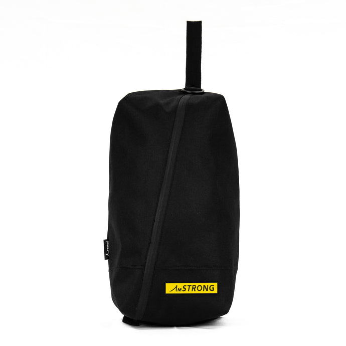 AmSTRONG black shoes bag with a diagonal zip and yellow metallic label