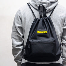 Load image into Gallery viewer, man in grey hoodie carrying black drawstring bag
