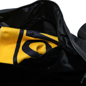 a yellow sport towel stashed in a zip pocket