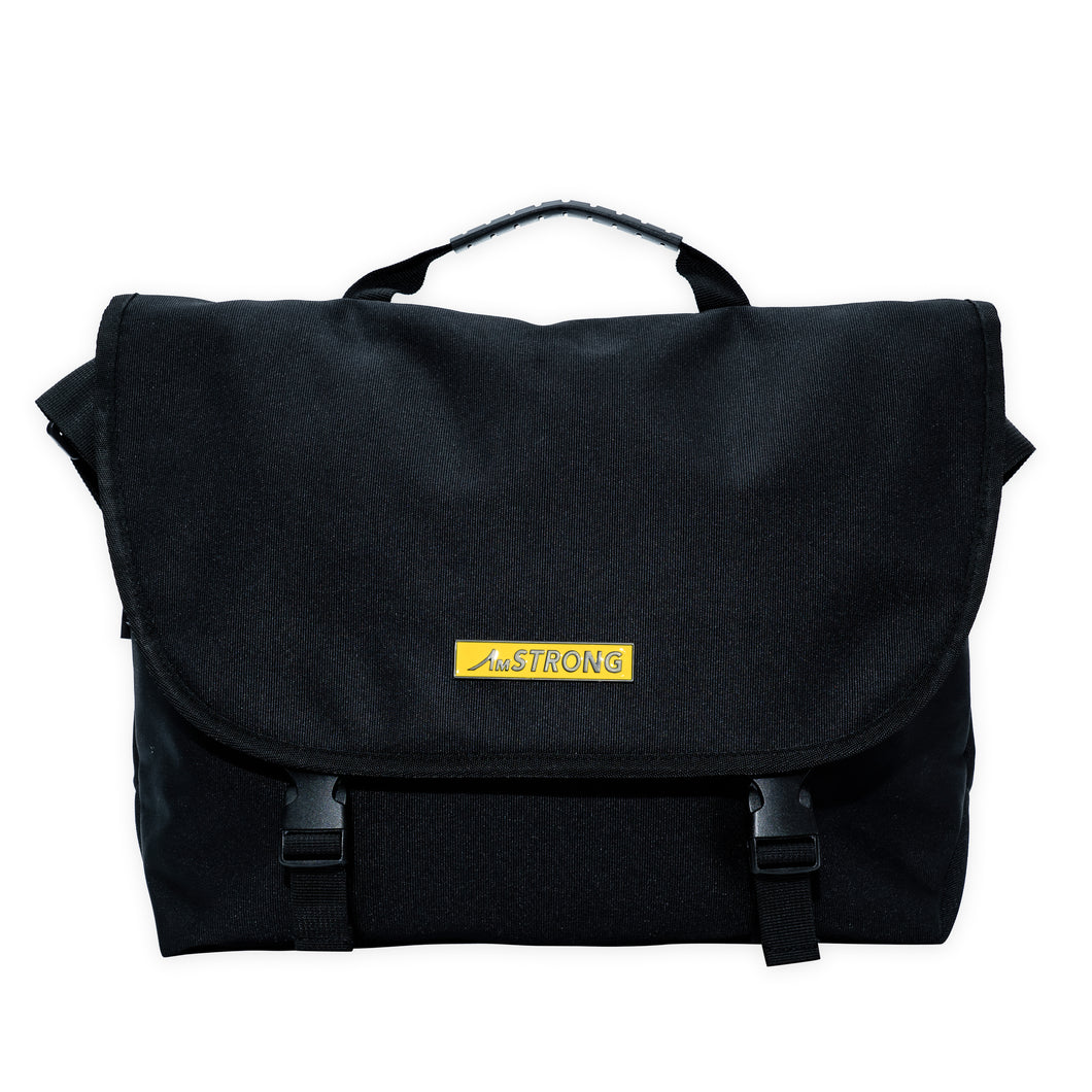 AmSTRONG black crossbody bag with a yellow metallic label
