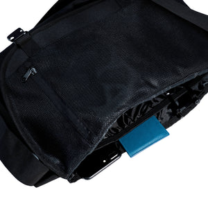 multiple pockets inside a black messenger bag