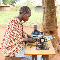 Woman-sewing-Uganda-Kleos-Microfinance-Group-Studio-15