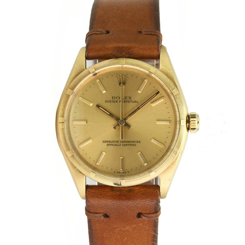 Pre-Owned Men's  Rolex Oyster Perpetual 1005 34mm 14k Yellow Gold Watch Champagne Stick Dial Engine-Turned Bezel Brown Leather - LSM WATCH