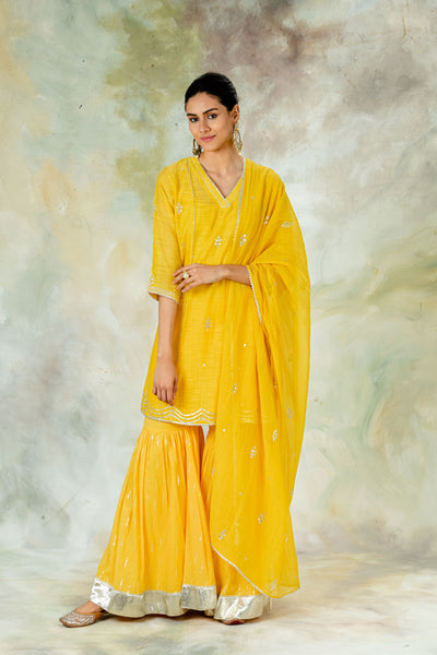 Mandira Wirk_DANDELION YELLOW KURTASET WITH GOTA SHARARA AND DUPATTA