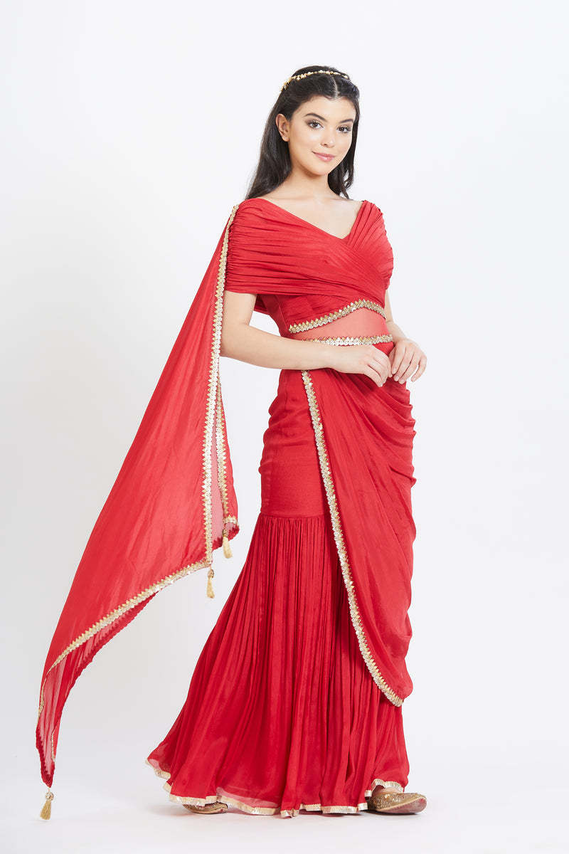 Red embroidered drape saree
