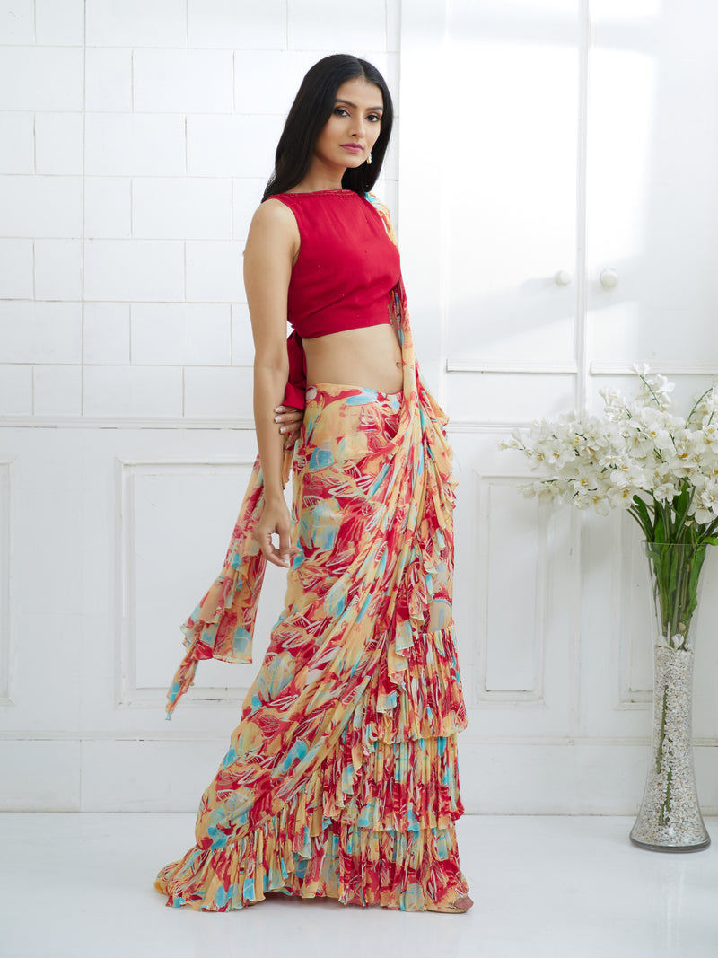 RED EMBROIDERED BACK KNOTTED BLOUSE WITH PRINTED  RUFFLE SAREE