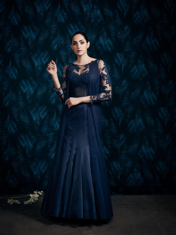NAVY BLUE DRAPED GOWN ENHANCED WITH INTRICATE EMBROIDERY.