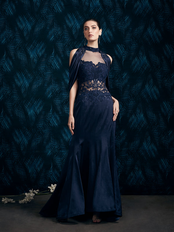 NAVY BLUE DRAPED GOWN ENHANCED WITH INTRICATE EMBROIDERY AND BACK TRAIL
