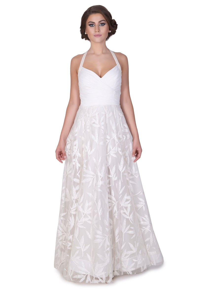 White halter neck pelted gown
