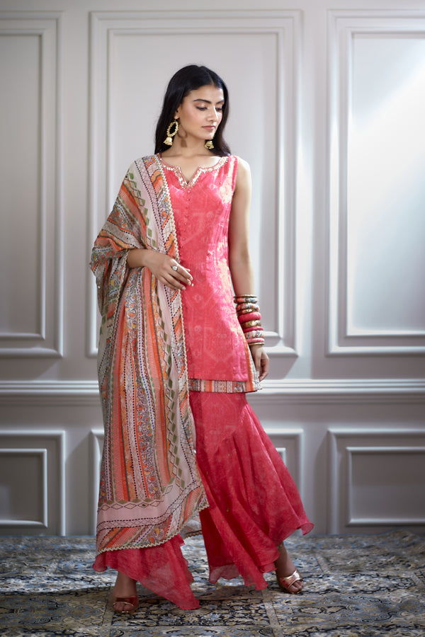 Pink printed layered short kurta with a sharara and a dupatta