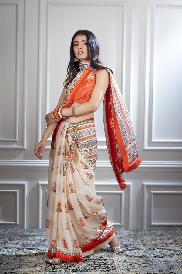 Ivory printed saree paired with a hand embroidered blouse
