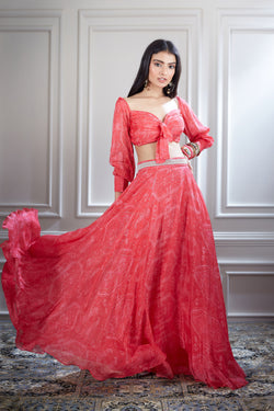 Pink printed chiffon lehenga paired with a knotted crop top
