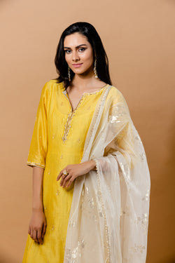 Yellow kurta with crinkled inner dress and dupatta