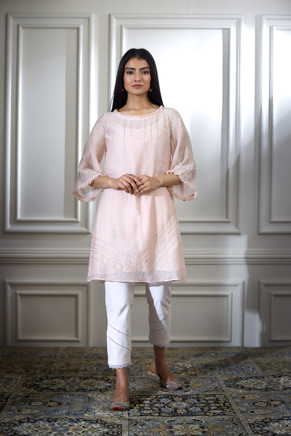 SOFT PEACH AARI EMBROIDRED TUNIC WITH PEARL HIGHLIGHTING PAIRED WITH ANKLE LENGTH PANTS
