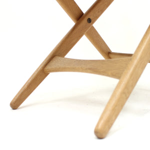 Oak and leather folding stool by Östen Kristiansson for Luxus, 1960s