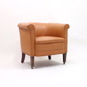 Brown leather club chair on castors, 1930s