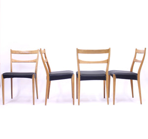 Scandinavian oak dining chairs with black leather seats, 1950s