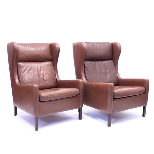 Pair of Scandinavian leather wingback chairs, attributed to Stouby, 1970s