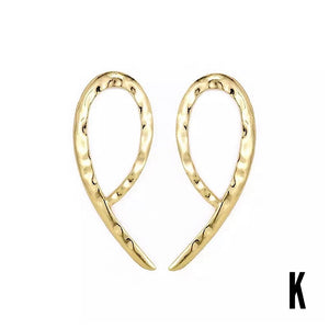 Bohemian Florianne Gold with an exaggerated twist Earrings