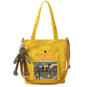Modakawa Crossbody Bag Cartoon Print Canvas Bag with Cute Froggy Pendant JUNIOR COMPANY Letter
