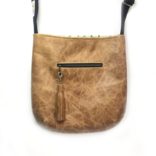 Across the body tan leather bag- round shape, flower lining
