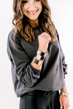 athleisure top, mom style, athletic wear, lightening bolt, trendy print for winter, tile stack bracelets, shop style your senses, women's boutique, style your senses, mallory fitzsimmons