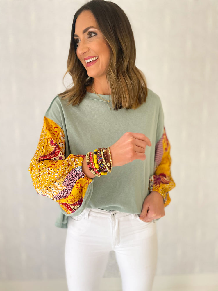 faded sage top with long mixed pattern sleeves, white skinny jeans, spring tops, stacked bracelets, affordable style, shop style your senses by mallory fitzsimmons