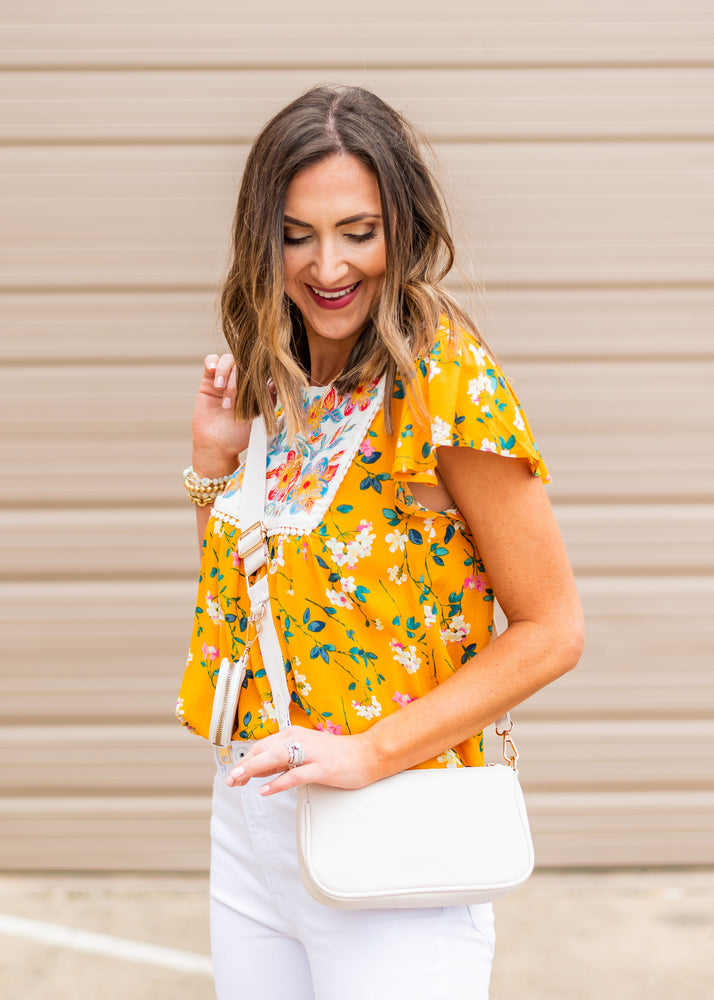 marigold mini floral top with embroidered bib, dreaming of spring, February collection, spring outfits, new arrivals, affordable style, shop style your senses by mallory fitzsimmons