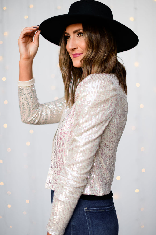 silver-sequin-jacket-holiday-launch-holiday-party-outfits-puff-shoulder-black-shoulder-pad-tee-denim-flare-jeans-layered-gold-necklace-black-wool-hat--black-velvet-quilted-clutch-shop-style-your-senses-by-mallory-fitzsimmons