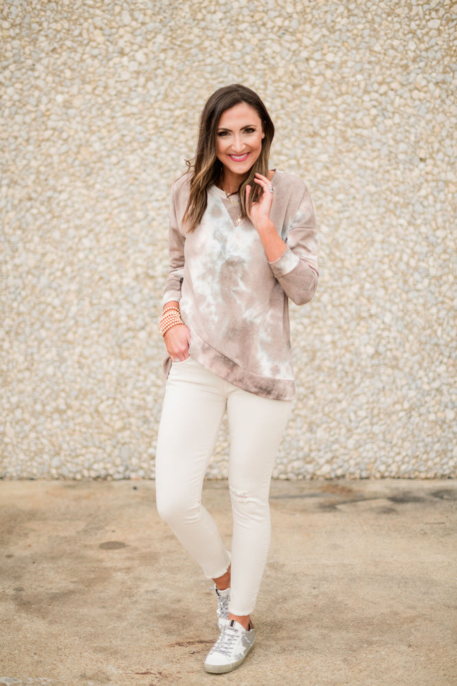 Beige Mid-Rise Distressed Skinny Jean, taupe tie dye Long sleeve top, gold bubble bracelets, glitter sneakers, fresh start, January collection, spring outfits, shop style your senses by Mallory Fitzsimmons