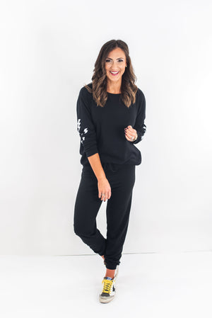 shop-style-your-senses-by-mallory-fitzsimmons-black-lightning-bolt-joggers-loungewear-cozy-clothes-affordable-fashion-Holiday-outfit