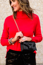 black-quilted-purse-with-gold-chain-holiday-accessory-holiday-party-outfits-shop-style-your-senses-by-mallory-fitzsimmons-red-mock-neck-sweater-sequin-joggers