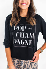 shop-style-your-senses-by-mallory-fitzsimmons-pop-the-champagne-sweatshirt-cozy-fashion-easy-to-wear-fun-comfortable-affordable-clothing-new-years-eve-at-home-casual-nye-outfit